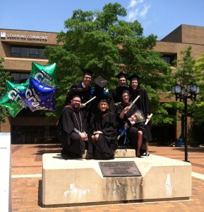 Six newly minted Creative Writing & Publishing Arts MFAs with the Edgar Allan Poe statue
